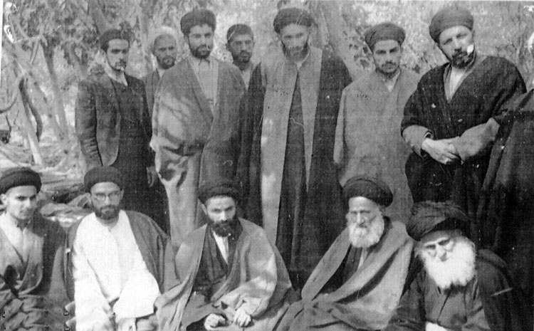 Ayatollah Taqi Qomi with His Father and Brothers