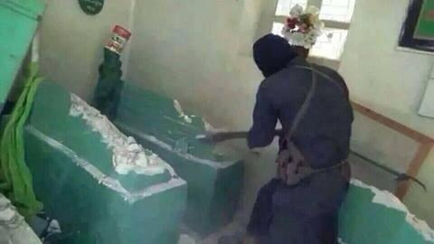 An ISIS man destroying grave of Prophet Younus