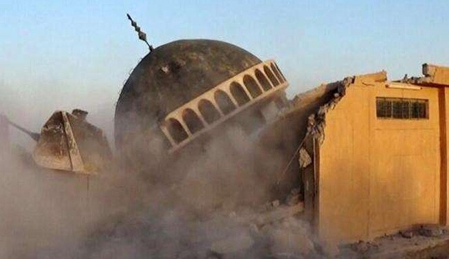 Pictures posted on the Internet by ISILshows a Sufi shrine was demolished by the terrorists in Iraq.